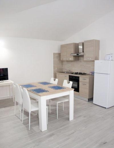 soggiorno con televisore, appartamento Perla, Calasetta
